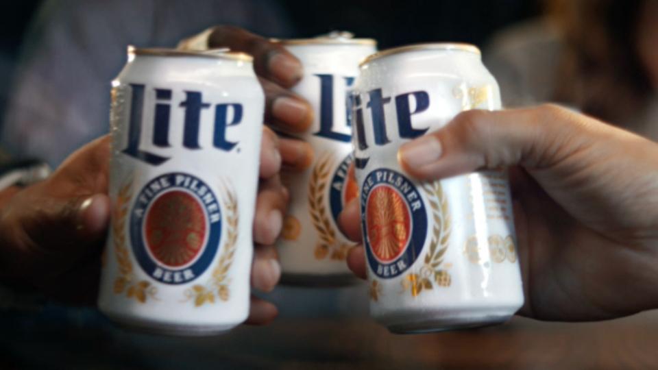 Miller Lite hands holding cans